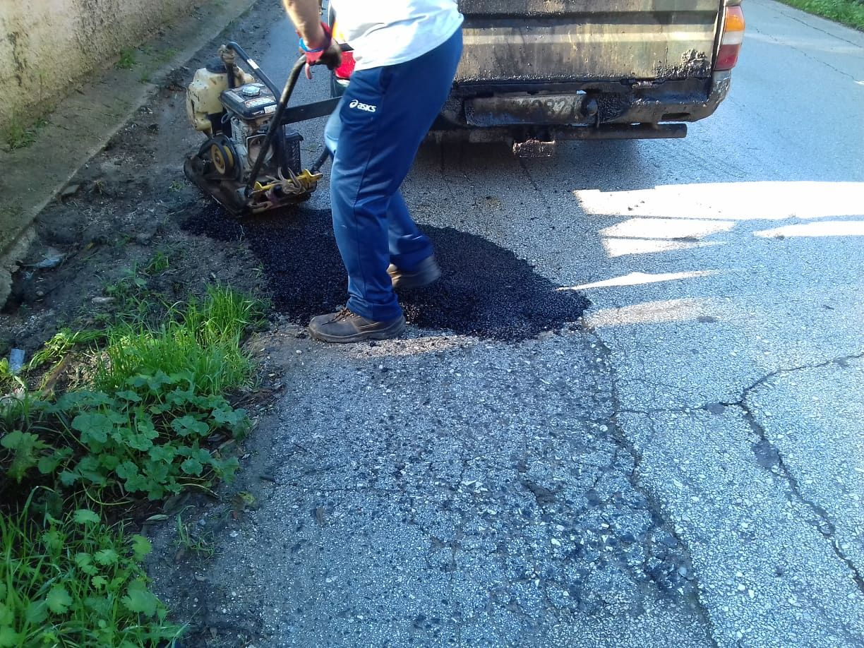 Municipal crews filling potholes